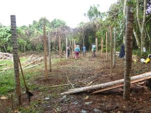 Building the hut with the locals at PRI Luganville